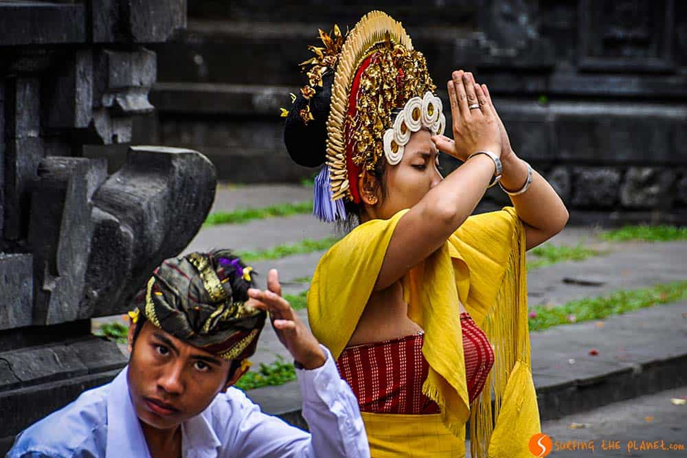 Bali temples - A woman praying in Pura Besakih