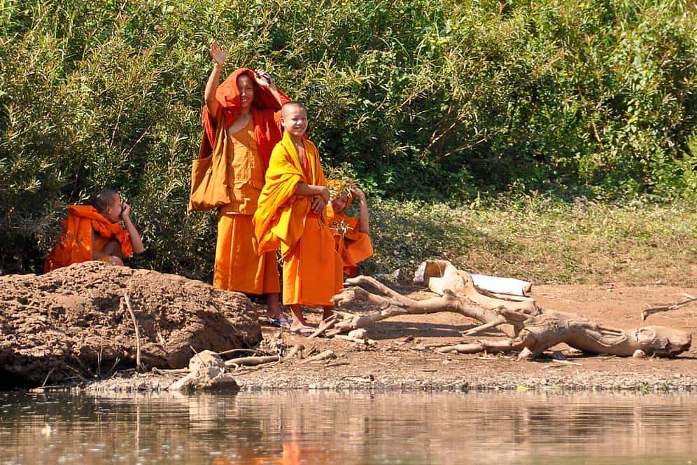 Buddhist monks close to the river