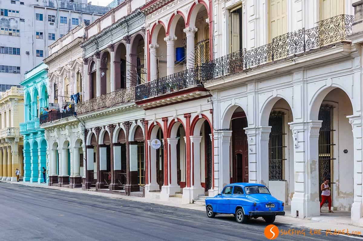 Blue car in front of colonial buildings Havana, Cuba. Travelling to Cuba