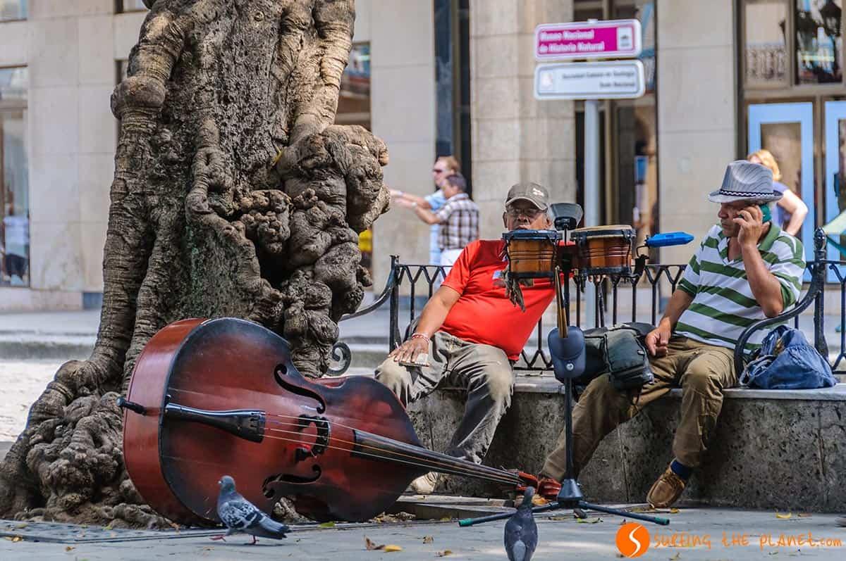 Musicians resting in Plaza de Armas in Havana. Traveling to Cuba